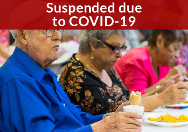 Suspended due to COVID-19, elderly individuals eating a meal