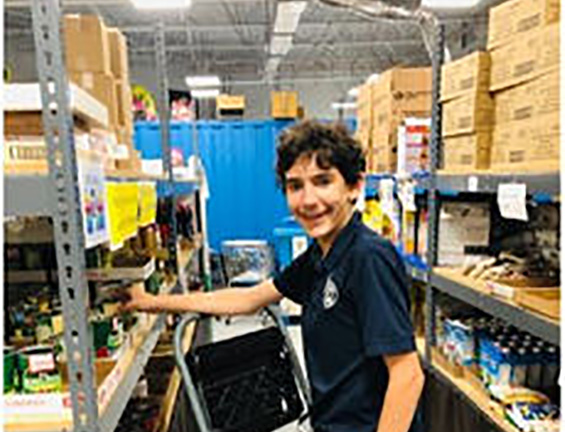 David stocking shelves at the JCS Kosher Food Bank