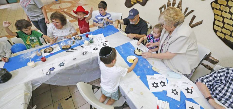 Seniors help children make Challah at Camp Gan Israel in Lauderhill, Aug. 3, 2015. CHARLES TRAINOR JR MIAMI HERALD STAFF
