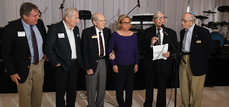 Individuals speaking at an event