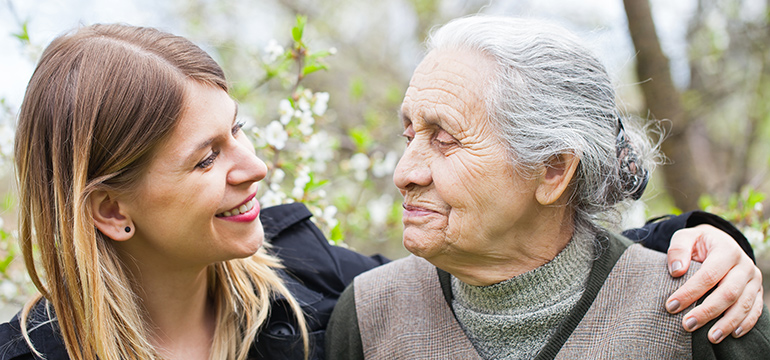 Happy elderly woman with granddaughter