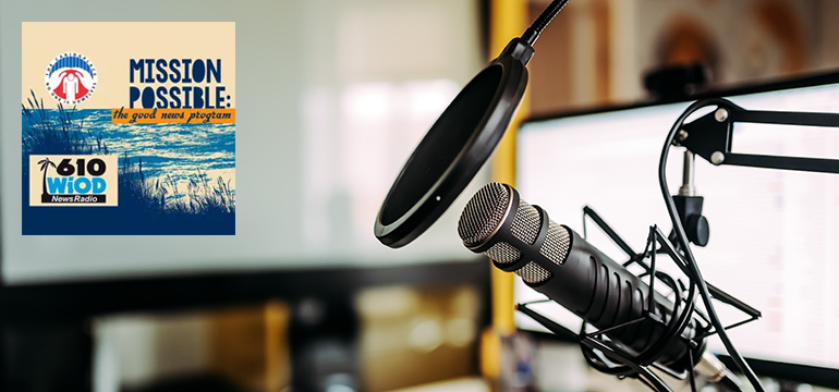Close-up image of microphone in podcast studio with the Mission Possible logo on it