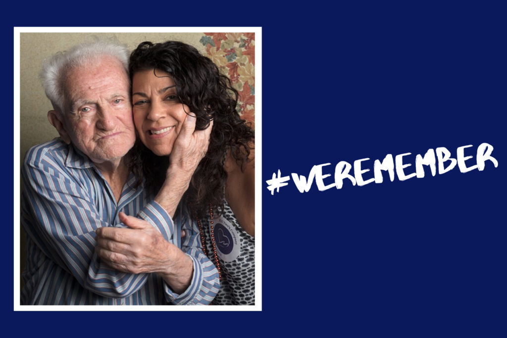 Holocaust survivor with a younger individual and #WEREMEMBER