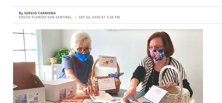 SunSentinel logo, Despite pandemic, agencies distribute High Holiday cards, food to seniors. Image of two women organizing greeting cards.